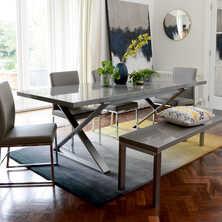 Crossed leg gloss extending dining table stone