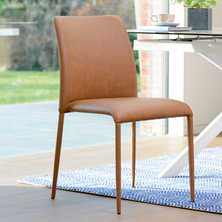 Svelte faux leather dining chair tan