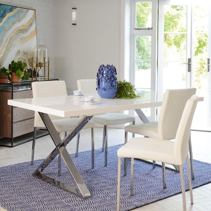 Crossed leg 6 seater dining table chrome legs white