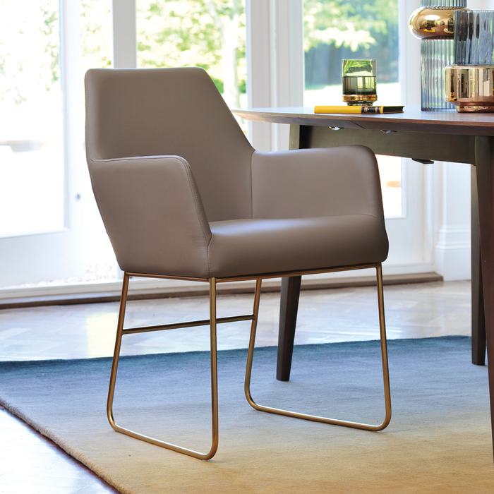 Trono dining armchair with brass leg stone